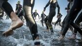 Triathletes take part in the 3800 m swimming leg of the Ironman Copenhagen 2015 in Copenhagen on August 23, 2015. AFP PHOTO / Scanpix Denmark / NIKOLAI LINARES DENMARK OUT AFP