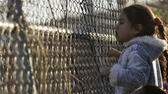 A child hangs on to a fence next to inmates' relatives outside the Topo Chico prison in Monterrey, Mexico, February 11, 2016. Fifty-two people were killed and twelve people were wounded in a prison riot in Monterrey in the northeastern Mexican state of Nuevo Leon, governor Jaime Rodriguez said in a news conference on Thursday. REUTERS/Daniel Becerril Reuters