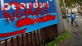 "An election campaign poster of Germany's anti-immigration Alternative for Germany party (AfD) reading ""Asylum fraud"" is seen repainted with ""No AfD"" slogan in Duisburg, Germany, September 14, 2017. Picture taken September 14, 2017. REUTERS/Wolfgang Rattay Reuters"