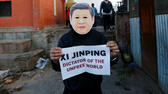 A Tibetan activist wearing a mask in the image of Chinese President Xi Jinping protests against what activists say is Chinese President Xi JinpingÕs oppressive rule in Tibet and the 19th National Congress of the Communist Party of China, in Kathmandu, Nepal, October 18, 2017. REUTERS/Navesh Chitrakar Reuters