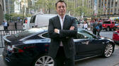 "huGO-BildID: 39283721 SpaceX billionaire founder and chief executive, and Tesla Motors CEO Elon Musk, poses beside a Tesla, after his interview on ""Countdown to the Closing Bell,"" on the Fox Business Network, in New York, Wednesday, Sept. 17, 2014. On Tuesday, NASA picked Boeing and SpaceX to transport astronauts to the International Space Station in the next few years.(AP Photo/Richard Drew) ap"
