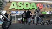 (FILES) In this file photo taken on January 10, 2018 customers come and go at a branch of Asda supermarket in south London. Britain's supermarket chain Sainsbury said Saturday, April 28, 2018, it was in talks to merge with rival Asda, in a deal that would create a retail giant with around 30 percent share of the British market. / AFP PHOTO / Justin TALLIS AFP