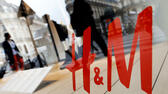 People walk past the window of a H&M store in Paris, France, August 24, 2015. REUTERS/Regis Duvignau/File Photo GLOBAL BUSINESS WEEK AHEAD PACKAGE Ð SEARCH ÒBUSINESS WEEK AHEAD JUNE 13Ó FOR ALL IMAGES Reuters, Sascha Rheker