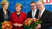 German Chancellor and head of the Christian Democratic Union (CDU) Angela Merkel (2ndL) poses with Rhineland-Palatinate's state election candidate Julia Kloeckner (L), Reiner Haseloff (R) in Sachsen-Anhalt region and Baden-Wuerttemberg's candidate Guido Wolf during the CDU's presidency and executive board meeting at ther party's headquarters in Berlin, on March 14, 2016 a day after election in three regional states. The CDU was at the receiving end of voter anger, suffering defeats in two out of three states in Sunday's elections -- including in its traditional stronghold Baden-Wuerttemberg. / AFP PHOTO / John MACDOUGALL AFP