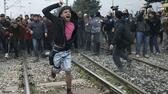 Refugees and migrants break through the Greek police cordon as they try to approach the Greek-Macedonian border, near the northern Greek village of Idomeni on Monday, Feb. 29, 2016. Macedonian police fired tear gas and stun guns Monday as several hundred Iraqi and Syrian refugees, frustrated at days of delays in crossing the Greek-Macedonian border, broke down a gate on a nearby rail crossing. (AP Photo/Petros Giannakouris) AP