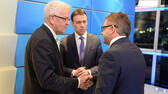 Baden-Wuerttemberg governor Winfried Kretschmann , of the Green party, left, talks with top candidate of the Social Democratic Party , SPD, Nils Schmid,, center and Christian Democrats top candidate Guido Wolf, right, in a TV studio in Stuttgart, southern Germany, Sunday March 13, 2016 after state elections in three German states. ( Bernd Weißbrod/Pool Photo via AP) AP