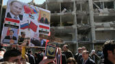 "huGO-BildID: 25630805 People hold a poster depicting Russian President Vladimir Putin and Chinese President Hu Jintao at a silent march in front of a damaged government building on al-Qassa street in Damascus, Syria, Sunday, March 18, 2012 in memory of people who were killed a day earlier by two attacks in the capital Damascus. Three suicide bombings in the capital Damascus on Saturday killed several people. The government blamed those on the opposition, which it claims is made up of ""terrorist"" groups carrying out a foreign conspiracy. (Foto:Bassem Tellawi/AP/dapd) dapd"