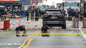 Federal Bureau of Investigation (FBI) officials mark the ground near the site of an explosion in the Chelsea neighborhood of Manhattan, New York, U.S. September 18, 2016. REUTERS/Rashid Umar Abbasi Reuters
