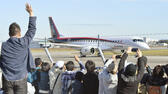 Spectators wave and take photos of Japan's first domestically produced passenger jet, the Mitsubishi Regional Jet (MRJ), taking off from Nagoya Airport in Toyoyama, central Japan, for its first flight Wednesday morning, Nov. 11, 2015. Mitsubishi, a maker of the Zero fighter, took a step toward reclaiming Japan's one-time status as an aviation power Wednesday with the maiden flight of its regional jet. (Yoshiaki Sakamoto/Kyodo News via AP) JAPAN OUT, CREDIT MANDATORY ap