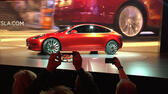 Tesla Motors unveils the new lower-priced Model 3 sedan at the Tesla Motors design studio Thursday, March 31, 2016, in Hawthorne, Calif. It doesn't go on sale until late 2017, but in the first 24 hours that order banks were open, Tesla said it had more than 115,000 reservations. Long lines at Tesla stores, reminiscent of the crowds at Apple stores for early models of the iPhone, were reported from Hong Kong to Austin, Texas, to Washington, D.C. Buyers put down a $1,000 deposit to reserve the car. (AP Photo/Justin Prichard) AP