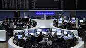 Traders work at their desks in front of the German share price index, DAX board, at the stock exchange in Frankfurt, Germany, February 27, 2017. REUTERS/Staff/Remote Reuters, Sascha Rheker