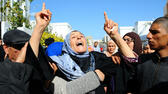 huGO-BildID: 42657184 Fatma Laabidi, mother of victim Yassine Laabidi, gestures as her son's coffin is transported from his home, in Jallez Cemetery, prior to his funeral, in Tunis, Sunday, March 22, 2015. The two extremist gunmen who killed 21 people at a museum in Tunis trained in neighboring Libya before caring out the deadly attack, a top Tunisian Security official said. (AP Photo/Salah Ben Mohamed) ap
