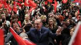 "Turkish President Recep Tayyip Erdogan (C) greets supporters as he attends a ""YES"" campaign meeting at Bestepe People's Culture and Congress Center in Ankara on March 29, 2017, three weeks ahead of the referendum on whether to change the current parliamentary system into an executive presidency. On April 16, 2017, the Turkish public will vote on whether to change the current parliamentary system into an executive presidency that would boost President Recep Tayyip Erdogan's powers. / AFP PHOTO / ADEM ALTAN AFP; Files; Francois Guillot"