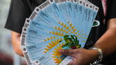 huGO-BildID: 37326966 FILE - A man shows his tickets after getting them at the opening of the FIFA Distribution Center of Tickets for Brazil 2014 World Cup in Rio de Janeiro, Brazil, 18 April 2014. EPA/Antonio Lacerda (zu dpa-Themenpaket zur Fußball-Weltmeisterschaft 2014 in Brasilien vom 04.06.2014) +++(c) dpa - Bildfunk+++ dpa